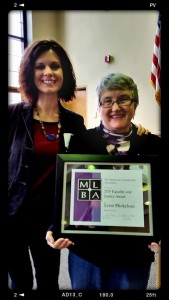 Lynn Mickelson receives her MLBA Equality and Justice Award, with MLBA board member Erin Keyes.
